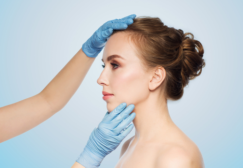 surgeon or beautician hands touching woman face over-img-blog