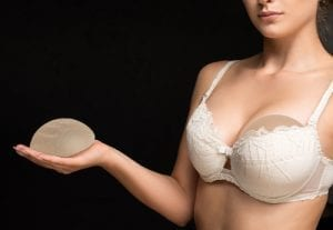 Silicone implants on hand and natural breast