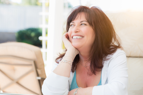 attractive middle aged woman smiles on the patio-img-blog