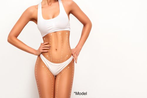 Woman considers liposuction to remove stubborn deposits of fat.