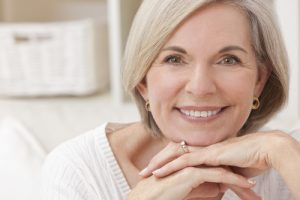 Portrait of an attractive elegant senior woman relaxing at home
