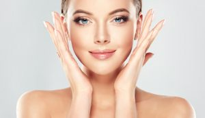 beautiful young woman with clean fresh skin touch own face-img-blog