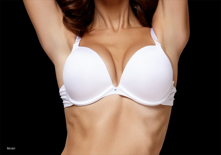 Woman wearing white bra