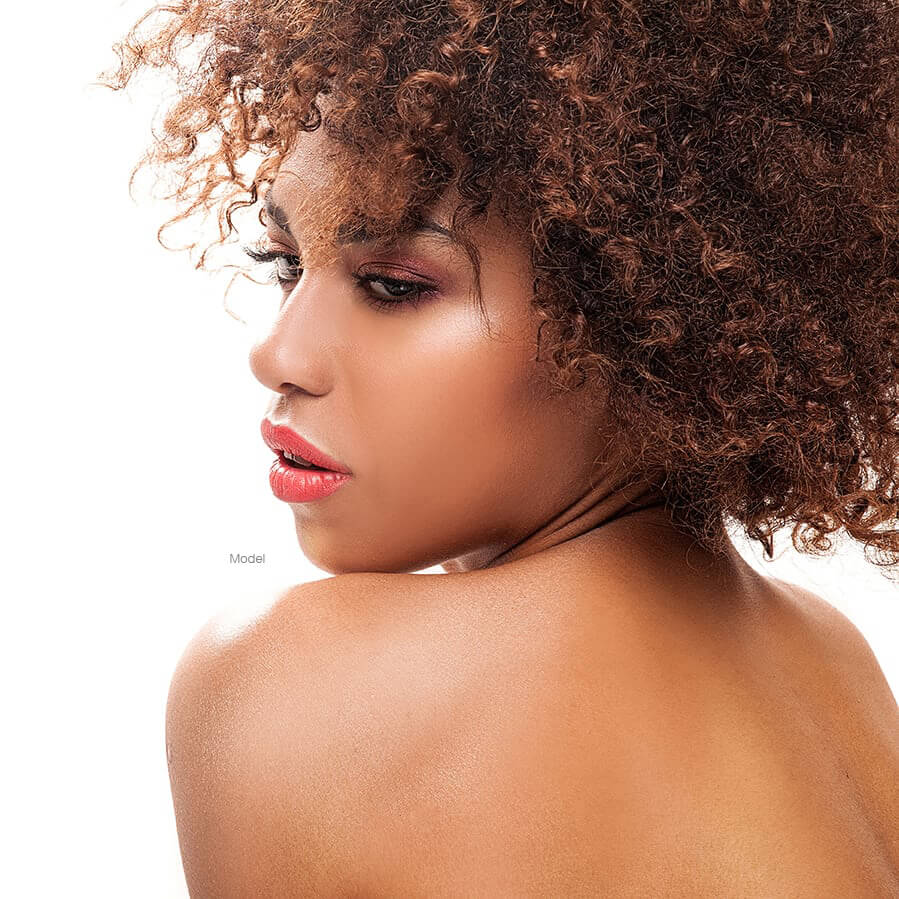 woman with curly hair looking over shoulders